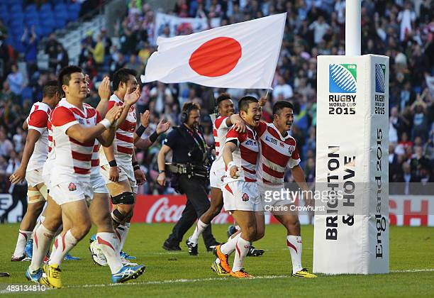Japan players celebrate their surprise victory in the 2015 Rugby World Cup Pool B match between South Africa and Japan at the Brighton Community...