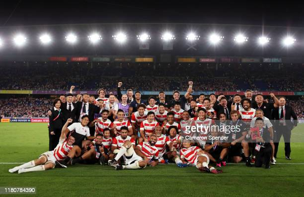 Japan players celebrate victory after the Rugby World Cup 2019 Group A game between Japan and Scotland at International Stadium Yokohama on October...