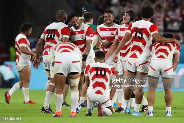 Japan players celebrate victory at the final whistle during the Rugby World Cup 2019 Group A game between Japan and Ireland at Shizuoka Stadium Ecopa...