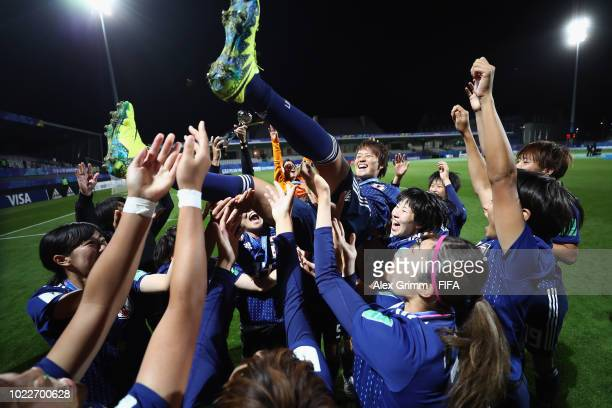 Japan players celebrate victory by throwing team captain Moeka Minami in the air after the FIFA U20 Women's World Cup France 2018 Final match between...