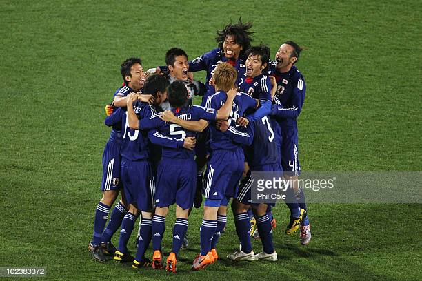 Japan players celebrate victory following the 2010 FIFA World Cup South Africa Group E match between Denmark and Japan at the Royal Bafokeng Stadium...