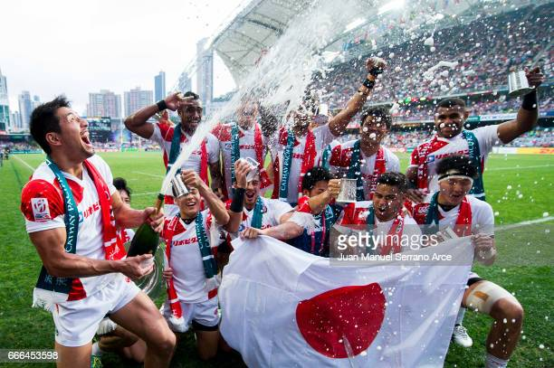 Japan players celebrate with the trophy after winning the Shield final match against Wales during the 2017 Hong Kong Sevens at Hong Kong Stadium on...