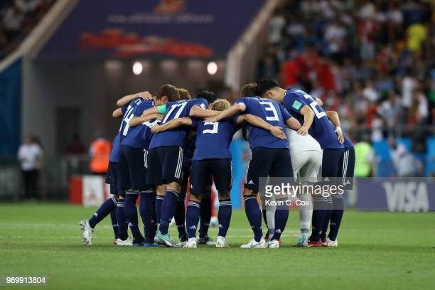 Japan players form a huddle prior to the 2018 FIFA World Cup Russia Round of 16 match between Belgium and Japan at Rostov Arena on July 2 2018 in...