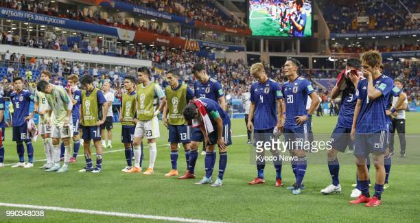 Japan players greet supporters after a 32 loss to Belgium in the World Cup round of 16 in RostovOnDon Russia on July 2 2018 ==Kyodo