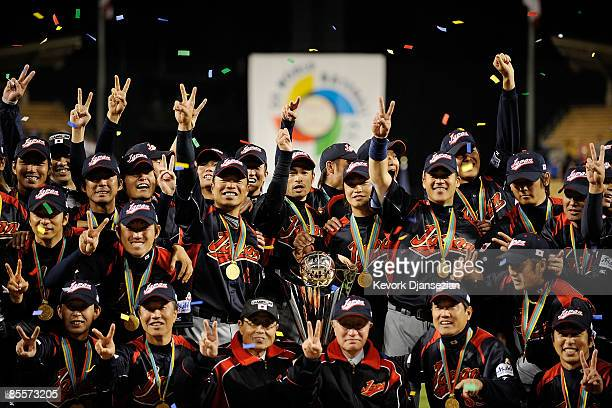 Japan players hold up the championship trophy after defeating Korea during the finals of the 2009 World Baseball Classic on March 23 2009 at Dodger...