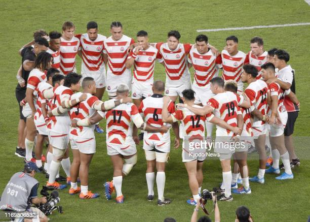 japan players huddle following teams victory