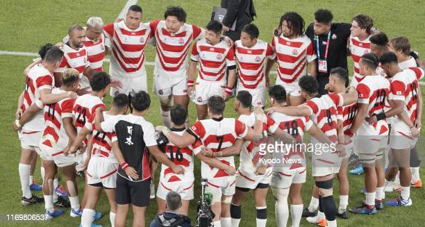 japan players huddle following teams victory