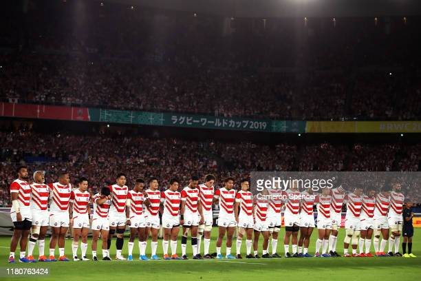 Japan players line up for the national anthem prior to during the Rugby World Cup 2019 Group A game between Japan and Scotland at International...
