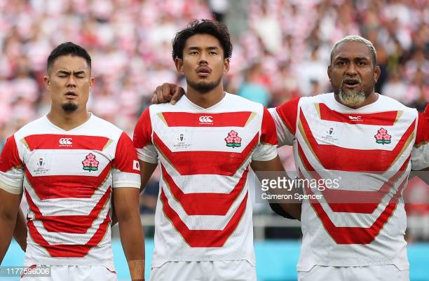 Japan players line up for the national anthem prior to the Rugby World Cup 2019 Group A game between Japan and Ireland at Shizuoka Stadium Ecopa on...