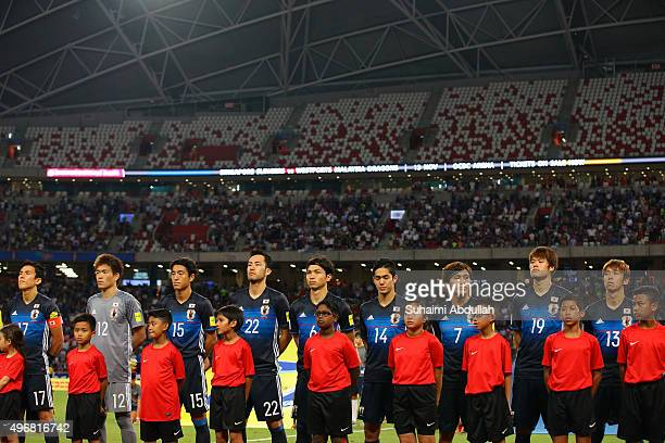 Japan players line up on the pitch during the 2018 FIFA World Cup Qualifier match between Singapore and Japan at National Stadium on November 12 2015...