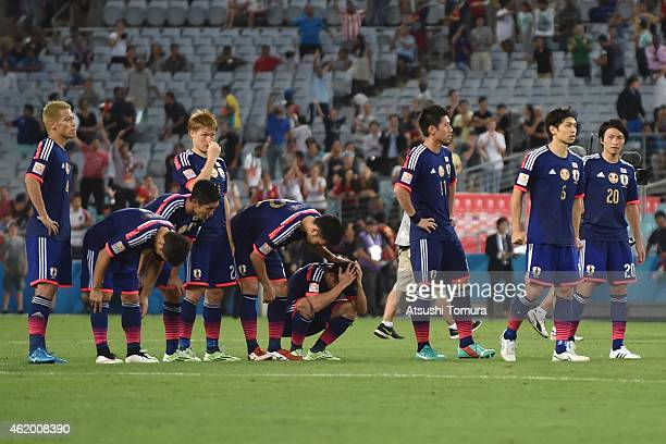 Japan players look dejected after losing the penalty shoot out during the 2015 Asian Cup Quarter Final match between Japan and the United Arab...