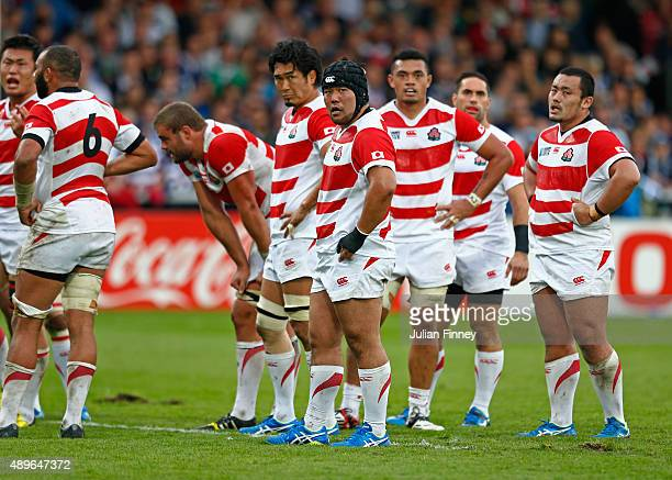 Japan players look dejected during the 2015 Rugby World Cup Pool B match between Scotland and Japan at Kingsholm Stadium on September 23, 2015 in...