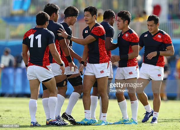 Japan players look on in defeat after the Men's Rugby Sevens semi final match between Fiji and Japan on Day 6 of the Rio 2016 Olympics at Deodoro...