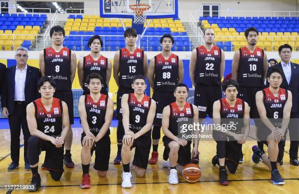 Japan players pose for a photo in Doha on Feb 24 before an Asian qualifier against Qatar for the basketball World Cup in China Japan won 9648 ==Kyodo