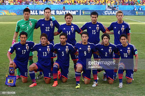 Japan players pose for a team photo during the 2014 FIFA World Cup Brazil Group C match between Japan and Colombia at Arena Pantanal on June 24 2014...