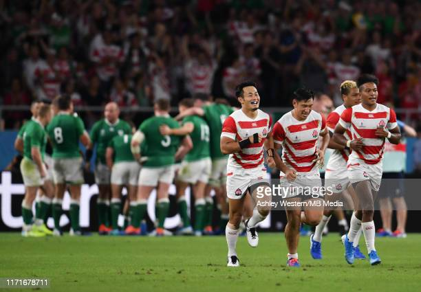 Japan players run back to the half way line after Kenki Fukuoka scores his sides try during the Rugby World Cup 2019 Group A game between Japan and...