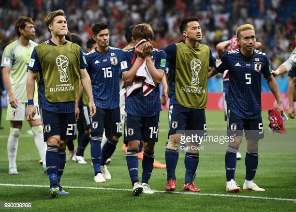 Japan players shows appreciation to the fans following their sides defeat in the 2018 FIFA World Cup Russia Round of 16 match between Belgium and...