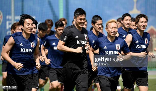 Japan players warm up during a training session at FC Rubin Kazan training ground on June 30 2018 in Kazan Russia