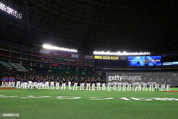 Japan playrs line up for national anthem during the sendoff friendly match for WBSC Premier 12 between Japan and Puerto Rico at the Fukuoka Dome on...