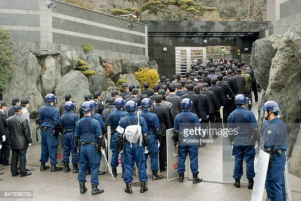 KITAKYUSHU Japan Police officers line up in front of the home of the boss of the Kudokai crime syndicate in Kitakyushu Fukuoka Prefecture on Feb 11...