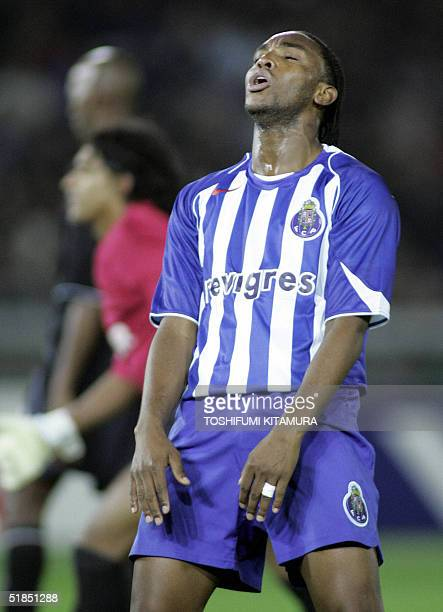 Portugese football club FC Porto forward Benedict McCarthy shows his dejection after missed his shoot in the Intercontinental Cup football final...