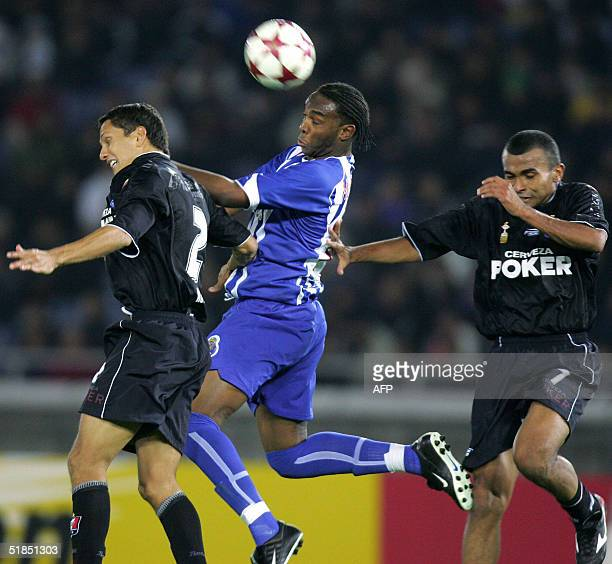 Portuguese FC Porto forward Benedict McCarthy and Colombian Once Caldas defenders Miguel Alberto Rojas Jefrey Diaz fight for the ball in the air...