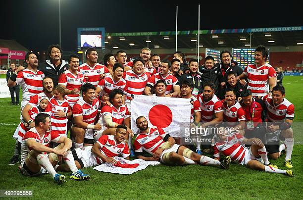 Japan pose for a team photogrpah after the 2015 Rugby World Cup Pool B match between USA and Japan at Kingsholm Stadium on October 11, 2015 in...