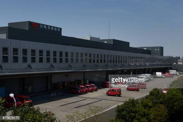 Japan Post Holdings Co Ltd trucks sit parked at a post office in Kawasaki Kanagawa Japan on Tuesday April 25 2017 Japan Post Holdings Co Ltdwill...