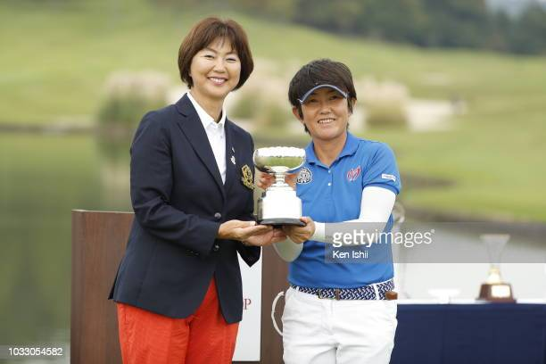 Japan President Hiromi Kobayashi and Ayumi Sobue of Japan pose with the trophy after winning the LPGA Legends Championship Chofu Cup at Shimonoseki...