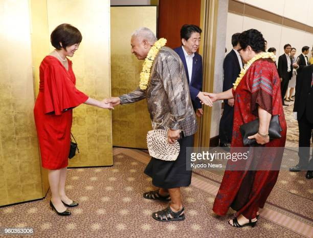 Japan Prime Minister Shinzo Abe and his wife Akie greet national leaders at the Pacific islands summit on May 18 in the northeastern Japan city of...