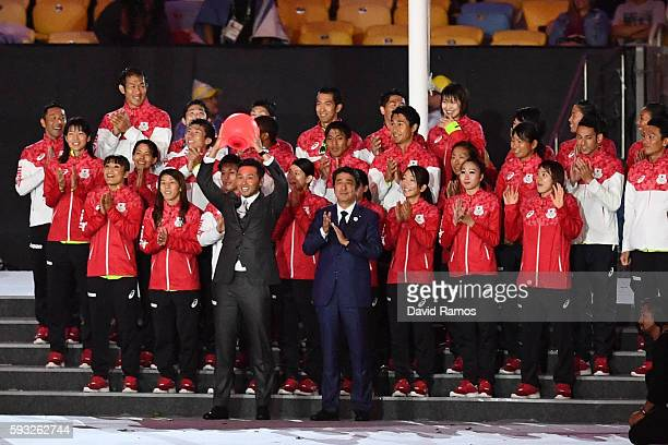 Japan Prime Minister Shinzo Abe and Kosuke Kitajima pose with members of Team Japan during the Closing Ceremony on Day 16 of the Rio 2016 Olympic...