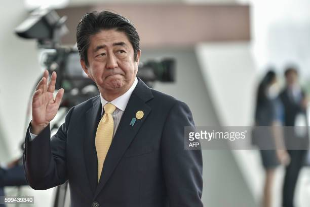 Japan Prime Minister Shinzo Abe arrives at the Hangzhou Exhibition Center to participate in the G20 Summit in Hangzhou on September 4, 2016. - G20...