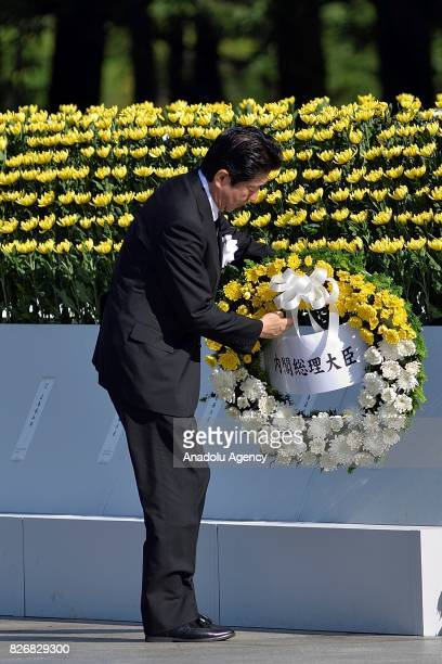 Japan Prime Minister Shinzo Abe attends a ceremony at the Hiroshima Peace Memorial Park on August 6 2017 in Hiroshima Japan Japan marks the 72nd...