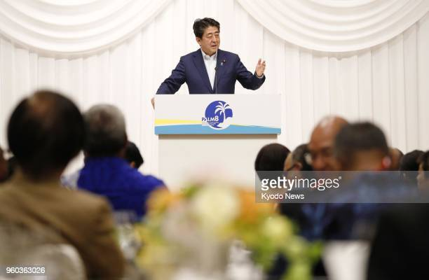 Japan Prime Minister Shinzo Abe delivers a speech at a banquet at the Pacific islands summit on May 18 in the northeastern Japan city of Iwaki...