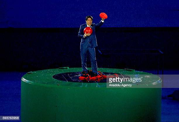 Japan Prime Minister Shinzo Abe is seen during the 'Love Sport Tokyo 2020' segment during the Closing Ceremony on Day 16 of the Rio 2016 Olympic...
