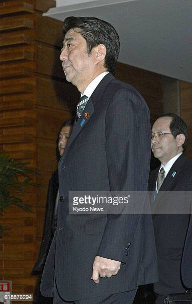 TOKYO Japan Prime Minister Shinzo Abe leaves his office in Tokyo on Jan 21 after attending a meeting of the government's task force on a hostage...