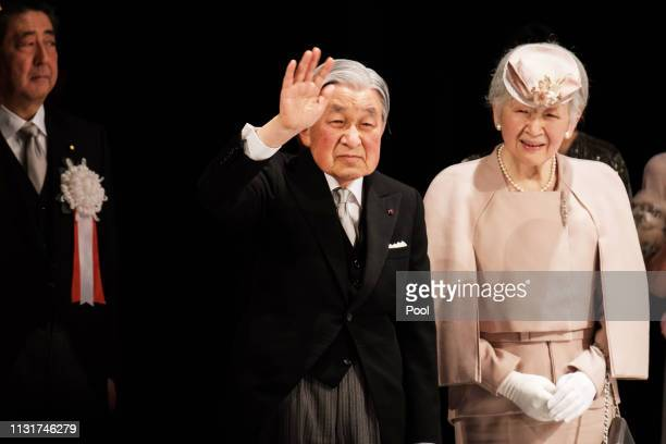 Japan Prime Minister Shinzo Abe stands as Japanese Emperor Akihito and Empress Michiko greet audience after a ceremony to mark the 30th anniversary...