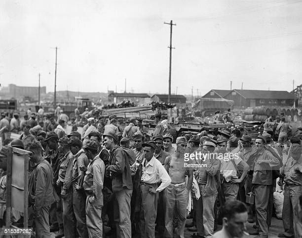 Prisoners of War at the dock area in Yokohama Japan waiting to be processed prior to boarding a hospital ship