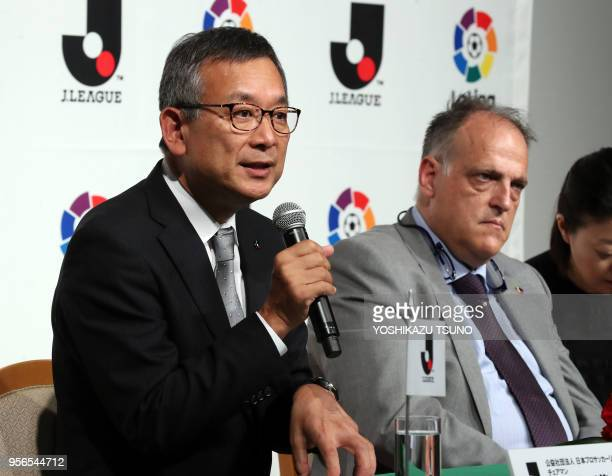 Japan Professional Football League chairman Mitsuru Murai speaks while Spanish professional football league LaLiga president Javier Tebas looks on as...