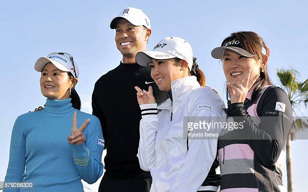 MIKI Japan Professional golfers Shinobu Moromizato Tiger Woods Miho Koga and Rui Kitada pose for photos at the Masters Golf Club in Miki Hyogo...