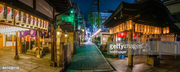Japan quiet alleyways of Osaka illuminated at night panorama