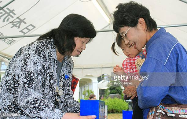 NIIGATA Japan Repatriated Japanese abduction victim Hitomi Soga collects donations in her hometown Sado Niigata Prefecture on Oct 7 for rescuing...