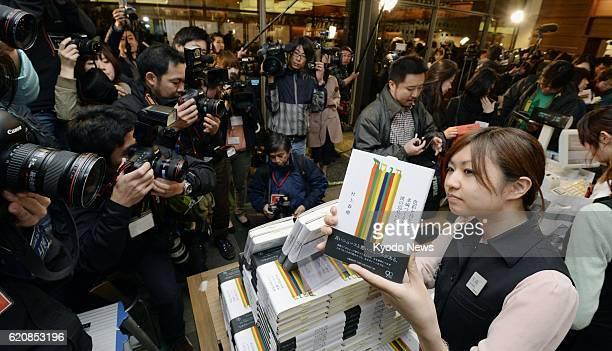 TOKYO Japan Reporters flock around copies of the new novel by acclaimed Japanese author Haruki Murakami titled 'Shikisaiwo motanai Tazaki Tsukuruto...