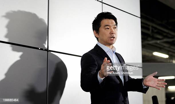 Japan Restoration Party acting president Toru Hashimoto speaks to the media reporters on November 18 2012 in Osaka Japan Hashimoto confirmed that...