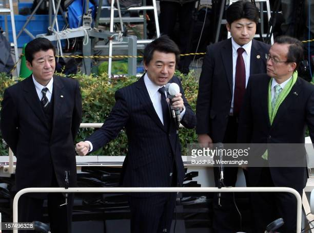 Japan Restoration Party deputy leader Osaka Mayor Toru Hashimoto speaks to voters during his official election party campaign for the upcoming lower...