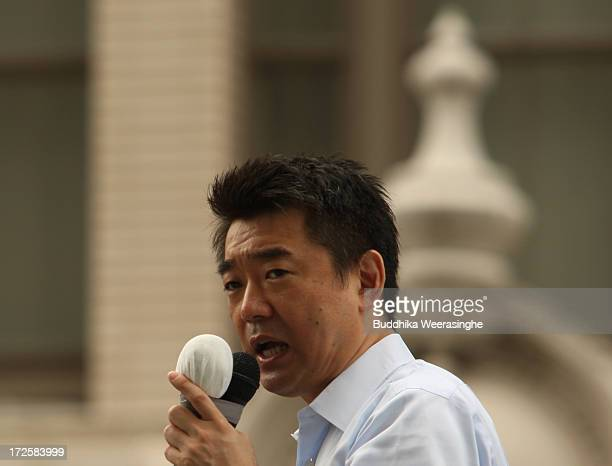Japan Restoration Party deputy leader Osaka Mayor Toru Hashimoto speaks to voters during his official election party campaign for the upcoming upper...