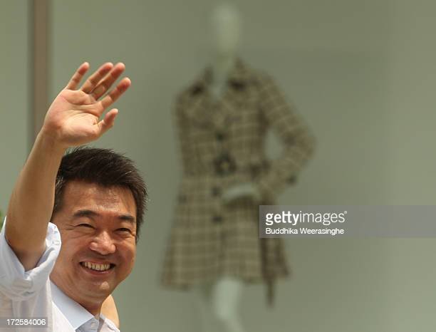 Japan Restoration Party deputy leader Osaka Mayor Toru Hashimoto waves to suppoters during his official election party campaign for the upcoming...