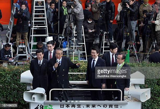 Japan Restoration Party leader former Tokyo Govener Shintaro Ishihara speaks to voters as deputy leader Osaka Mayor Toru Hashimoto looks from the...
