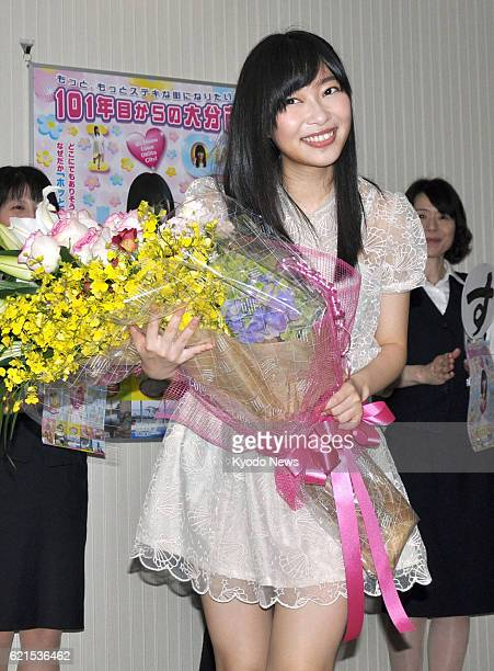 OITA Japan Rino Sashihara of the idol group HKT48 receives a bouquet while visiting the Oita city hall in Oita Prefecture southwestern Japan on June...