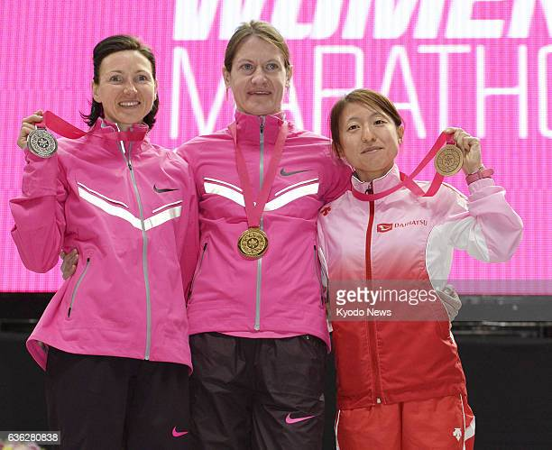 NAGOYA Japan Russia's Mariya Konovalova stands on the podium after winning gold in the Nagoya Women's Marathon in central Japan on March 9 2014 At...